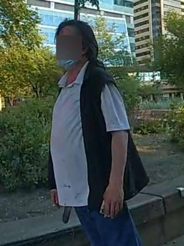 Calgary police said they are releasing images of a man stabbed on June 30 in James Short Park in the hopes that potential witnesses will recognize his clothing. His face has been obscured as he cannot be publicly identified until after an autopsy takes place. (Submitted by Calgary Police Service - image credit)