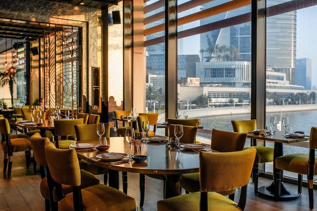 <p><strong>Give us an overview of the space.</strong> Coya has moody lighting, steel lattice room dividers, worn leather booths, and floor-to-ceiling windows with views of the waterway and glimmering Al Maryah Island.</p> <p><strong>What was the crowd like?</strong> A sleek international crowd in blazers and black dresses.</p> <p><strong>What should we be drinking?</strong> The cocktails here are as delicate and balanced as the food. Pisco sours come with optional infusions, from dates and vanilla, to pear and sandalwood.</p> <p><strong>Main event: the food. Give us the lowdown—especially what not to miss.</strong> The kitchen honors Peruvian classics while striking a balance between high-technique twists and subtlety. Even when dishes veer from tradition, they're executed well. Ceviches like the salmon Nikkei—salmon in celery juice, ginger, and wasabi tobiko—as well as the Buri Ahumado (smoked amberjack, crispy kombu, pomegranate, and aji rocoto) are Peruvian-style seafood at its best, but the veal ribs with sesame and pickled radish offers more than a little reason to order meat, too.</p> <p><strong>How did the front-of-house folks treat you?</strong> The staff is generous and forthcoming with pointed recommendations.</p> <p><strong>What's the real-real on why we're coming here?</strong> Come to get transported to halfway across the world and take a break from Abu Dhabi for an hour or two.</p>