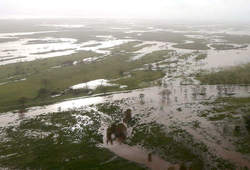 FILE PHOTO: Flooded areas can be seen from an Australian Army helicopter after Cyclone Debbie passed through the area near the town of Bowen, located south of the northern Queensland town of Townsville in Australia