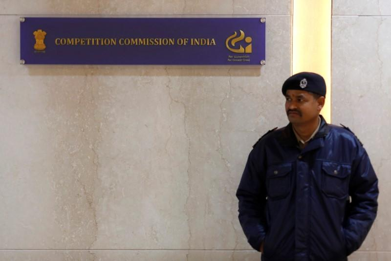 A security guard stands outside the Competition Commission of India (CCI) headquarters in New Delhi
