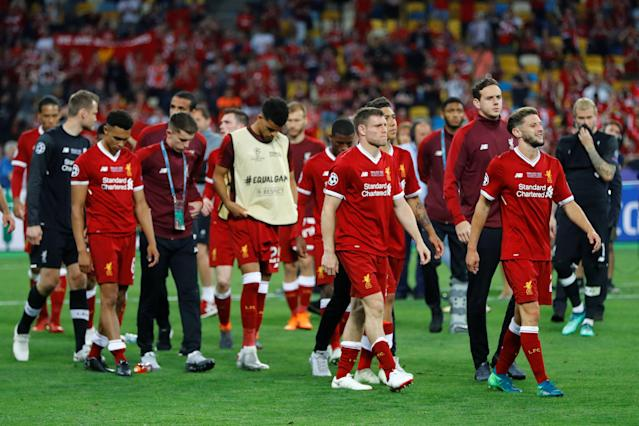 Soccer Football - Champions League Final - Real Madrid v Liverpool - NSC Olympic Stadium, Kiev, Ukraine - May 26, 2018 Liverpool's James Milner and team mates react after the match REUTERS/Kai Pfaffenbach