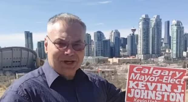 Kevin J. Johnston, who has been threatening health workers and faces an assault charge, is running for mayor of Calgary. (Derek Storie/Facebook - image credit)