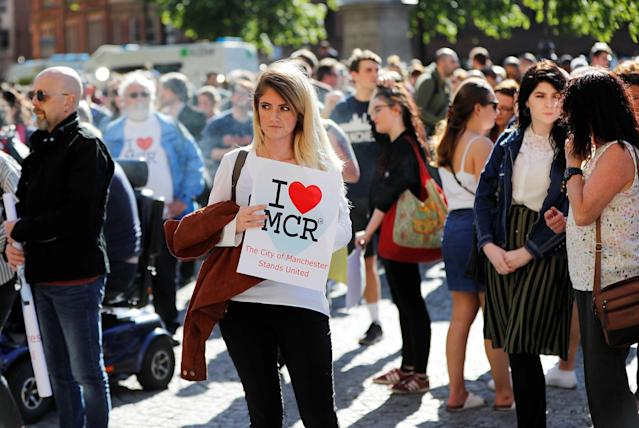 <p>A woman waits to take part in a vigil for the victims of an attack on concert goers at Manchester Arena, in central Manchester, Britain on May 23, 2017. (Darren Staples/Reuters) </p>