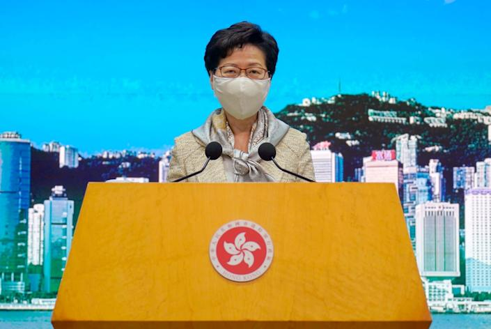 Hong Kong chief executive Carrie Lam speaks at a weekly press conference on Tuesday, 30 June, as Beijing passed a controversial new national security law: AP