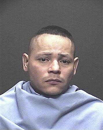 Fernando Richter, 34, is pictured in this handout booking photo courtesy of the Tucson Police Department and received by Reuters November 27, 2013. REUTERS/Tucson Police Department/Handout