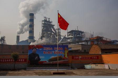 A poster showing Chinese President Xi Jinping is seen in front of the Xinyuan Steel plant in Anyang, Henan province, China, February 19, 2019.  REUTERS/Thomas Peter