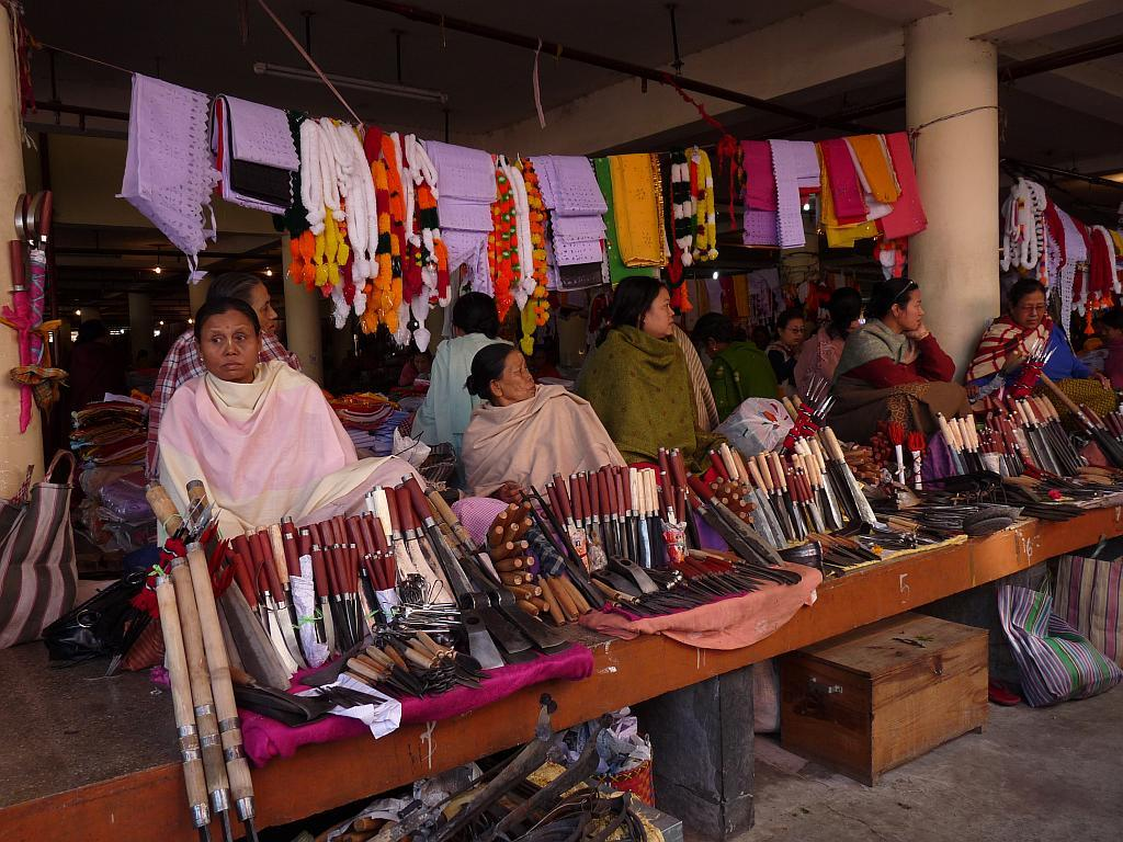 Women sell farming and kitchen implements and other hardware in Ima Market, Imphal.