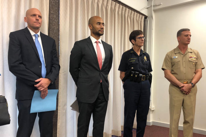 Left to right, NCIS Special Agent Norman Dominesey, U.S. Attorney for Hawaii Kenji Price, Honolulu Police Chief Susan Ballard and Rear Adm. Robert Chadwick, the commander of Navy Region Hawaii, listen during a news conference Friday, December 6, 2019, about the Pearl Harbor Naval Shipyard shooting. The U.S. Navy sailor who fatally shot two people at Pearl Harbor before killing himself was unhappy with his commanders and had been undergoing counseling, a military official said Friday. (AP Photo/Jennifer Sinco Kelleher)