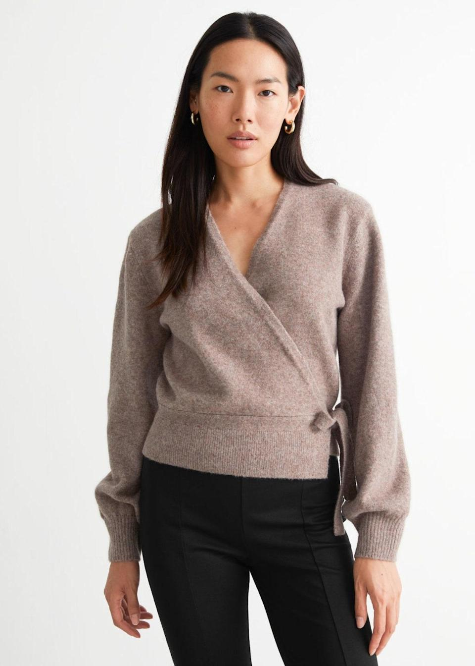 """This ballet-inspired wrap will put a romantic spin on all your ensembles. And doesn't it look deliciously soft? $59, & Other Stories. <a href=""""https://www.stories.com/en_usd/clothing/knitwear/cardigans/product.wrap-cardigan-beige.1008612003.html"""" rel=""""nofollow noopener"""" target=""""_blank"""" data-ylk=""""slk:Get it now!"""" class=""""link rapid-noclick-resp"""">Get it now!</a>"""