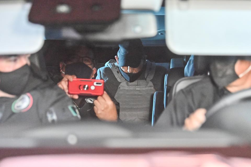 An unidentified person with a vest is seen in a convoy transporting the former chief executive of Mexico's state oil company PEMEX, Emilio Lozoya, to the General Attorney office following his extradition from Spain, in Mexico City on July 17, 2020. - Lozoya, PEMEX chief from 2012 to 2018, is accused of accepting millions of dollars in bribes from scandal-tainted Brazilian construction giant Odebrecht. (Photo by Pedro PARDO / AFP) / The erroneous mention appearing in the metadata of this photo by PEDRO PARDO has been modified in AFP systems in the following manner: [An unidentified person with a vest is seen in a convoy transporting the former chief executive of Mexico's state oil company PEMEX, Emilio Lozoya,...] instead of [Emilio Lozoya, former chief executive of Mexico's state oil company PEMEX, is seen...]. Please immediately remove the erroneous mention from all your online services and delete it from your servers. If you have been authorized by AFP to distribute it (them) to third parties, please ensure that the same actions are carried out by them. Failure to promptly comply with these instructions will entail liability on your part for any continued or post notification usage. Therefore we thank you very much for all your attention and prompt action. We are sorry for the inconvenience this notification may cause and remain at your disposal for any further information you may require. (Photo by PEDRO PARDO/AFP via Getty Images)