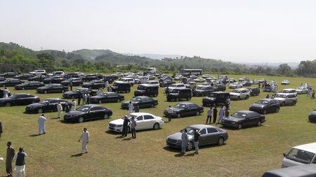 People visit an auction of government owned used cars at the premises of Prime Minister House in Islamabad, Pakistan September 17, 2018. REUTERS/Faisal Mahmood