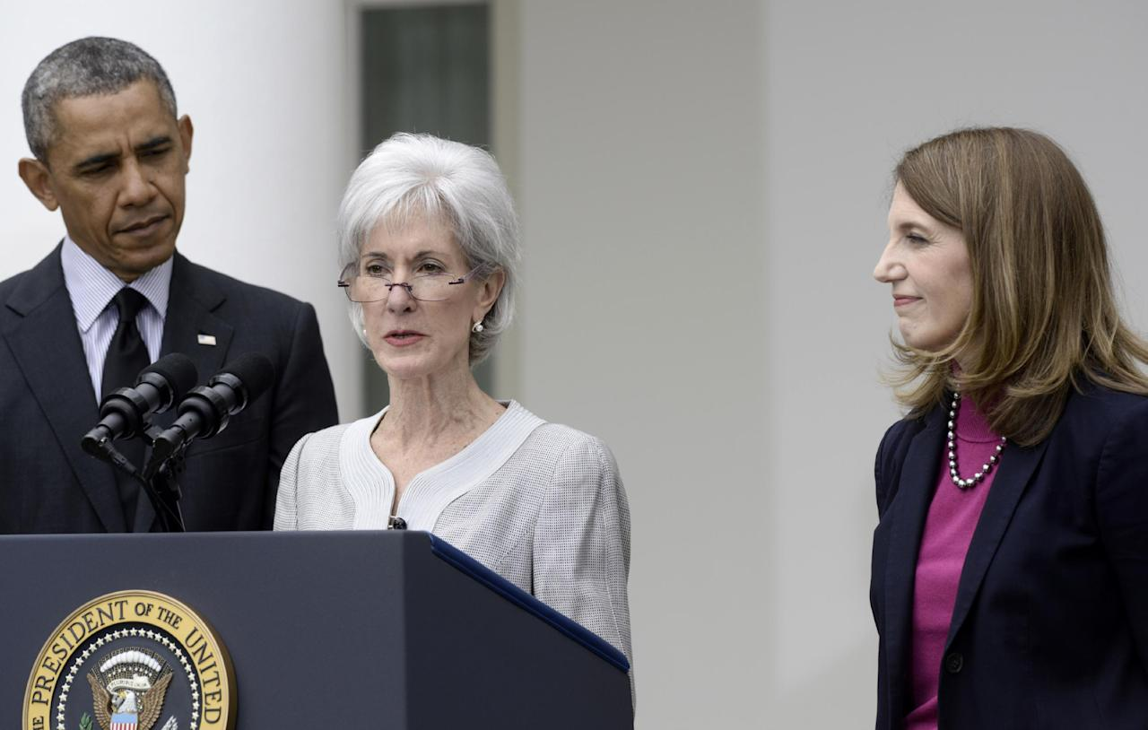President Barack Obama and his nominee to become Health and Human Services secretary, Budget Director Sylvia Mathews Burwell, right, listen as outgoing HHS Secretary Kathleen Sebelius speaks in the Rose Garden of the White House in Washington, Friday, April 11, 2014, where the president made the announcment. (AP Photo/Susan Walsh)