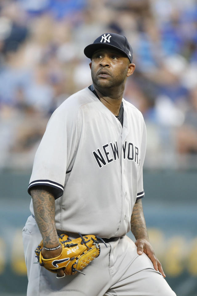 New York Yankees pitcher CC Sabathia looks out at the scoreboard after walking in a run with bases loaded against the Kansas City Royals in the third inning of a baseball game at Kauffman Stadium in Kansas City, Mo., Friday, May 18, 2018. (AP Photo/Colin E. Braley)