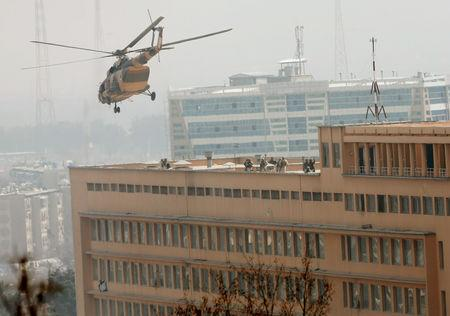 FILE PHOTO: Afghan National Army (ANA) soldiers descend from helicopter on a roof of a military hospital during gunfire and blast in Kabul, Afghanistan March 8, 2017.REUTERS/Mohammad Ismail/File Photo