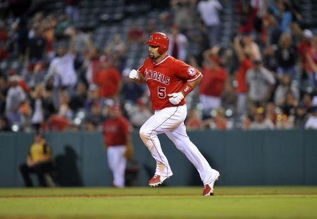 Los Angeles Angels first baseman Albert Pujols (5) runs the bases after he hits a solo home run in the nineteenth inning against the Boston Red Sox at Angel Stadium of Anaheim. Gary A. Vasquez-USA TODAY Sports