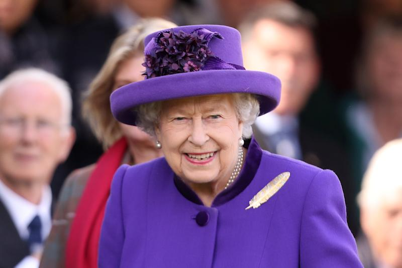 A photo of Queen Elizabeth II wearing a purple outfit during the 2019 Braemar Highland Games at The Princess Royal and Duke of Fife Memorial Park on September 07, 2019 in Braemar, Scotland.