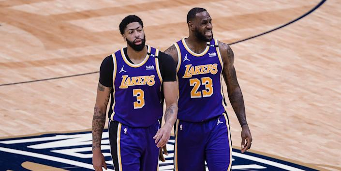 Anthony Davis and LeBron James walk side-by-side during a game.