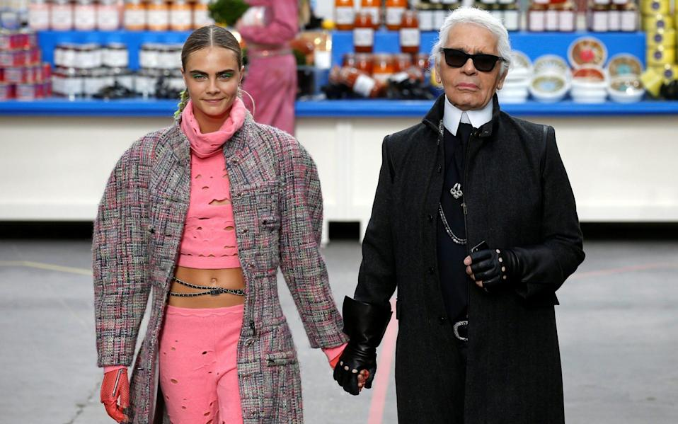 Cara Delevingne on the Chanel catwalk in Paris, with Karl Lagerfeld in 2014