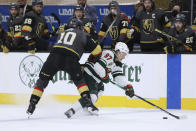 Minnesota Wild left wing Kirill Kaprizov (97) vies for the puck against Vegas Golden Knights center Nicolas Roy (10) during the second period of Game 7 of an NHL hockey Stanley Cup first-round playoff series Friday, May 28, 2021, in Las Vegas. (AP Photo/Joe Buglewicz)