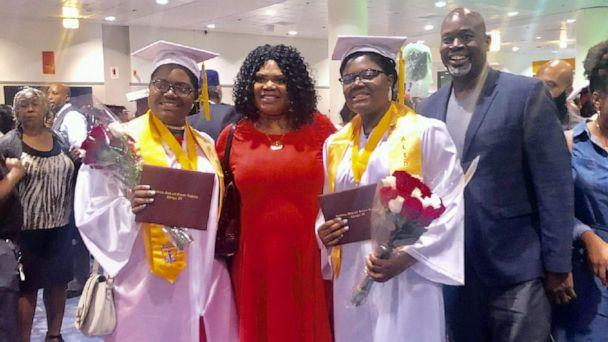 PHOTO: Tyra and Tia Smith, 18, are seen with their parents, Lemi-Ola Erinkitola and Terry Smith Sr. at the Lindblom Math and Science Academy graduation in West Englewood, Ill., on June 8, 2019. (Courtesy Lemi-Ola Erinkitola)