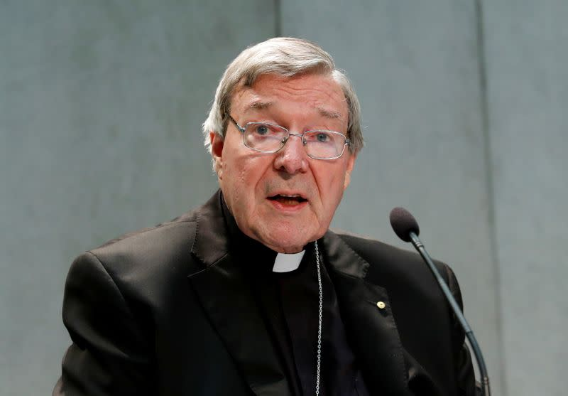 iFILE PHOTO: Cardinal George Pell attends a news conference at the Vatican
