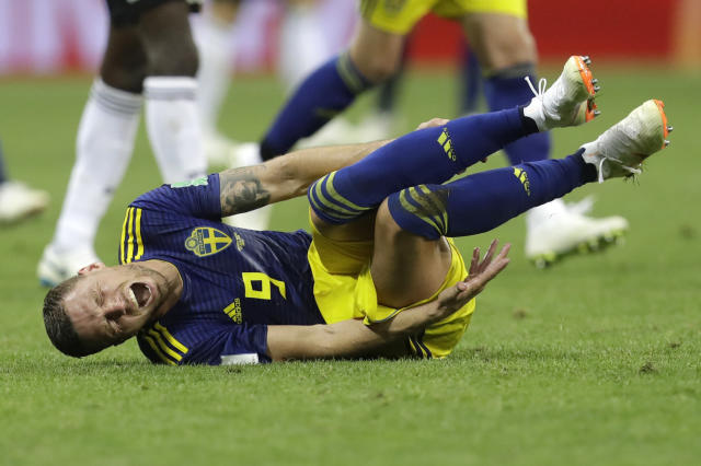 Sweden's Marcus Berg cries in pain after a foul during the group F match between Germany and Sweden at the 2018 soccer World Cup in the Fisht Stadium in Sochi, Russia, Saturday, June 23, 2018. (AP Photo/Michael Probst)