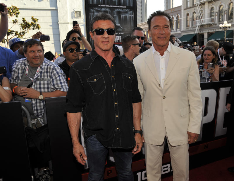 """Sylvester Stallone, left, and Arnold Schwarzenegger arrive at the """"Escape Plan"""" special screening on Day 2 of Comic-Con International on Thursday, July 18, 2013 in San Diego, Calif. (Photo by Chris Pizzello/Invision/AP)"""