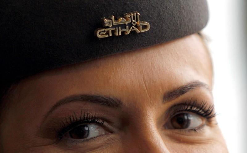 Etihad flight attendant is seen during a news conference at Malpensa Airport near Milan