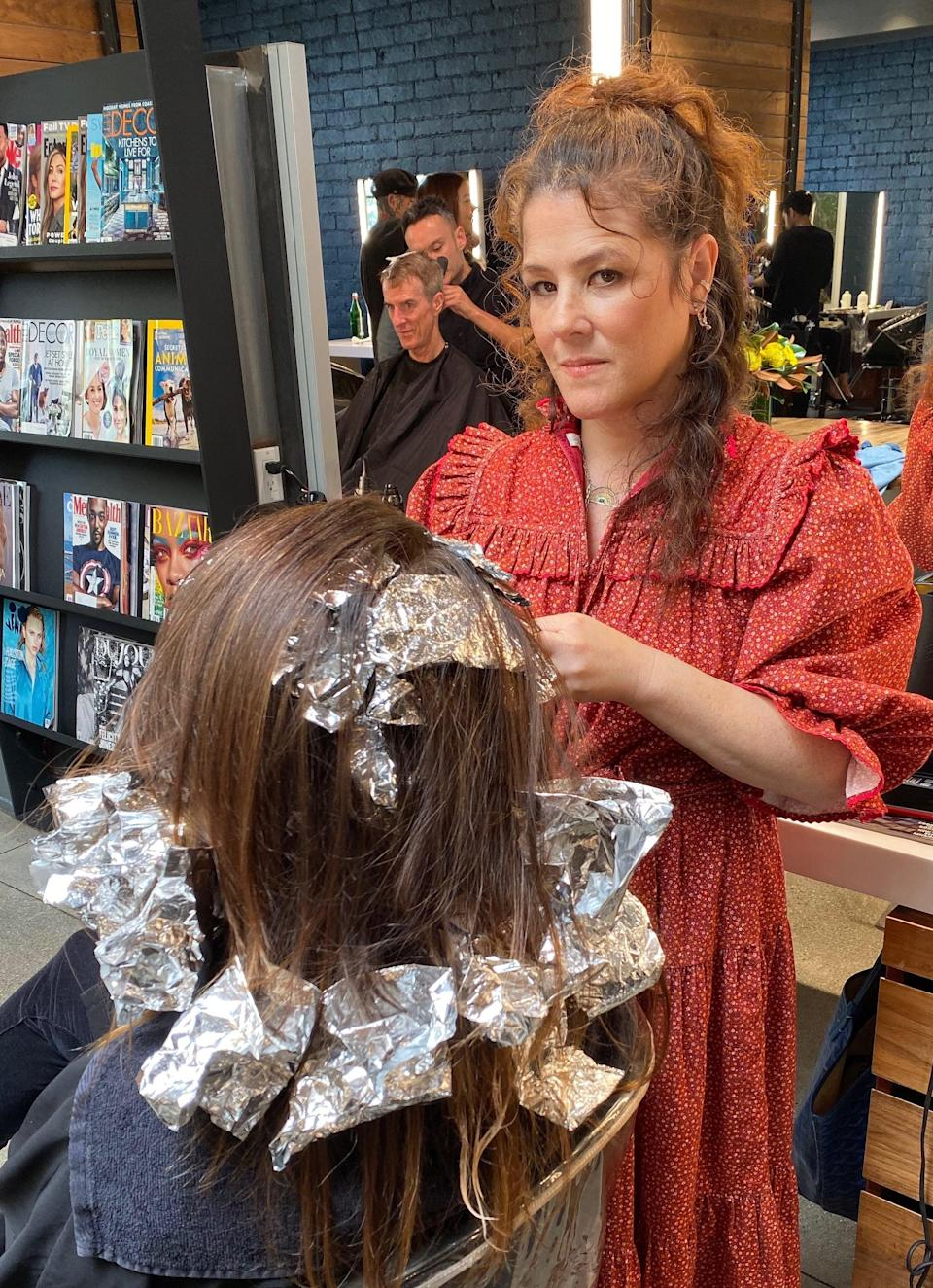 """<p>She advocated going to cosmetology school part-time while finishing her high school degree to her principal and started learning at the Gene Juarez Beauty Academy, which she calls """"the nicest salon in Seattle,"""" in their advanced training center. </p> <p>""""You would pay to be in this program, but you would also work and get paid,"""" Cunningham said. """"I did the laundry, I swept, and I got people coffee. It was the best job, and I was so inspired."""" She did that while nannying for Bette Midler, who paid for the schooling. </p> <p>It wasn't all smooth sailing. Being self-taught, a lot of what Cunningham was learning in beauty school went against how she had always done it. """"I remember one of my teachers telling me that I didn't hold my blow-dryer properly - I don't hold it where everybody else holds it, I hold it by the nozzle,"""" said Cunningham. """"She said, 'You're not doing it right,' and I looked at her and said, 'If you can blow-dry hair as good as me, then I'll hold my blow-dryer like you.' That was not good to say.""""</p> <p>After beauty school, Middler introduced her to Lily Aldridge's parents, Laura Lyons and Alan Aldridge, and her older brother Miles Aldridge, a fashion photographer (Lily was only four at the time). Miles had recently shot a <strong>W Magazine</strong> cover, which happened to be for former stylist Art Luna, or """"Hollywood's Hippest Hairdresser,"""" as the cover said in bold letters. Cunningham knew instantly that she had to work there and reached out. """"It was a great experience,"""" she said. </p> <p>After that, word of her work spread in the celebrity circle. She began working with <a class=""""link rapid-noclick-resp"""" href=""""https://www.popsugar.com/Portia-de-Rossi"""" rel=""""nofollow noopener"""" target=""""_blank"""" data-ylk=""""slk:Portia de Rossi"""">Portia de Rossi</a>, then came Anjelica Huston, Angela Featherstone, and <a class=""""link rapid-noclick-resp"""" href=""""https://www.popsugar.com/Ren%C3%A9e-Zellweger"""" rel=""""nofollow noopener"""" target=""""_blank"""" data-ylk=""""slk:Renée Zell"""