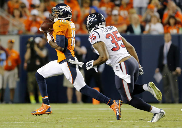 Denver Broncos wide receiver Emmanuel Sanders (10) pulls in a touchdown pass as Houston Texans defensive back Eddie Pleasant (35) pursues during the first half of an NFL preseason football game, Saturday, Aug. 23, 2014, in Denver. (AP Photo/Joe Mahoney)