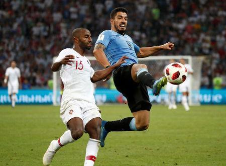 Soccer Football - World Cup - Round of 16 - Uruguay vs Portugal - Fisht Stadium, Sochi, Russia - June 30, 2018 Portugal's Ricardo Pereira in action with Uruguay's Luis Suarez REUTERS/Murad Sezer