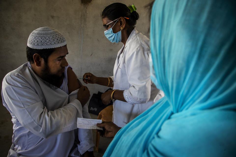 A health worker administers the vaccine for COVID-19 in Khola Bhuyan village on the outskirts of Gauhati, India, Tuesday, Sept. 7, 2021. (AP Photo/Anupam Nath)