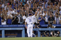Los Angeles Dodgers starting pitcher Max Scherzer takes a curtain call during the seventh inning of a baseball game against the Houston Astros in Los Angeles, Wednesday, Aug. 4, 2021. Scherzer threw 109 pitches, and struck out ten Astro batters. (AP Photo/Alex Gallardo)