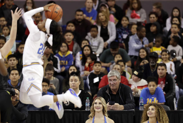 Bill Laimbeer, bottom right sitting, head coach of the WNBA Las Vegas Aces watches an NCAA college basketball game between UCLA and Oregon Sunday, Jan. 13, 2019, in Los Angeles. (AP Photo/Marcio Jose Sanchez)