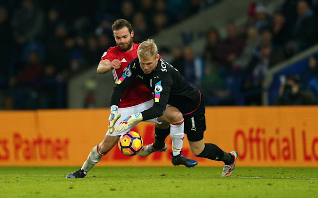 <p>eicester City's Danish goalkeeper Kasper Schmeichel (R) makes a save to prevent Manchester United's Spanish midfielder Juan Mata having a shot on goal during the English Premier League football match between Leicester City and Manchester United at King Power Stadium in Leicester, central England on February 5, 2017. </p>
