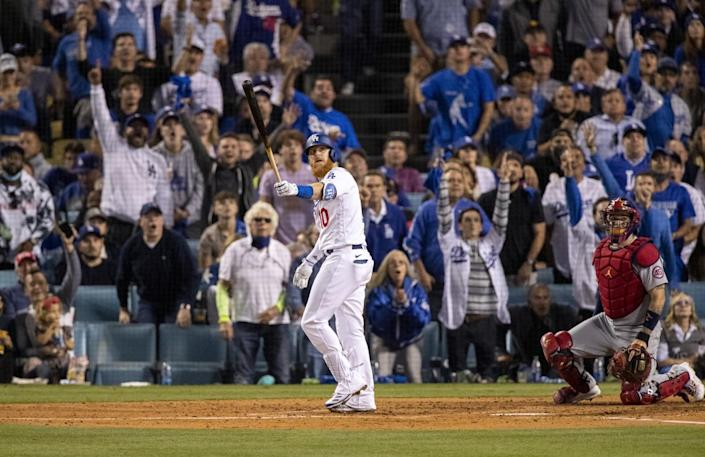 Los Angeles Dodgers third baseman Justin Turner (10) watches his solo homer clear the left field wall.