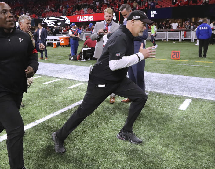 Atlanta Falcons head coach Dan Quinn dashes off the field with a 24-12 victory over the Jacksonville Jaguars during the final home game of the season in a NFL football game on Sunday, December 22, 2019, in Atlanta. (Curtis Compton/Atlanta Journal-Constitution via AP)