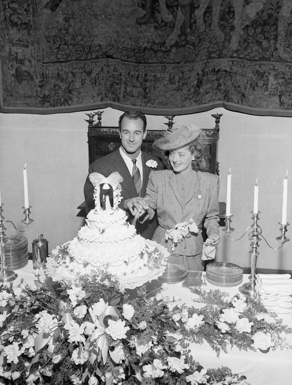 <p>Bette Davis wore a tweed suit and a wide brimmed hat to marry her third husband, William Grant Sherry, during their California ceremony. </p>