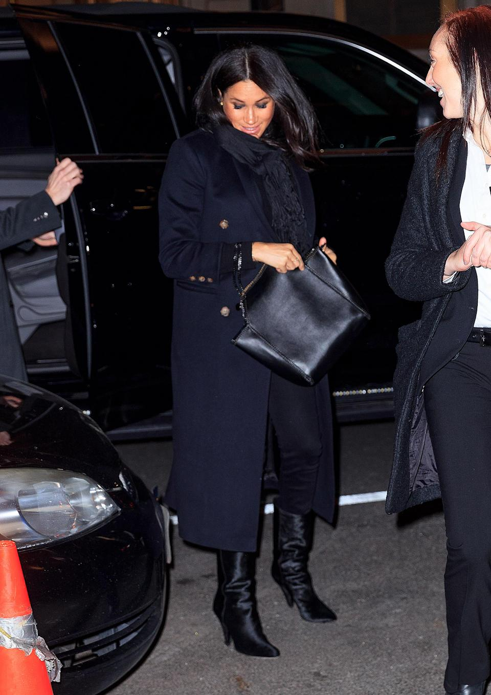 For dinner with friends in NYC, Meghan wore a Victoria Beckham coat, Stella McCartney bag and Hatch maternity jeans. A new pair of velvet boots finished off the look. [Photo: Getty]