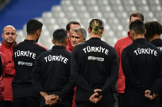Turkey coach Senol Gunes speaks to his players ahead of their Euro 2020 qualifier against France on Monday, which will be played against a tense diplomatic backdrop (AFP Photo/Lucas BARIOULET)