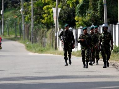 Sri Lanka Special Task Force soldiers patrol along a road. Reuters