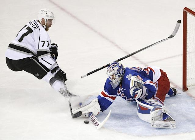 New York Rangers goalie Henrik Lundqvist (30) blocks a shot by Los Angeles Kings center Jeff Carter (77) in the second period during Game 4 of the NHL hockey Stanley Cup Final, Wednesday, June 11, 2014, in New York. (AP Photo/Frank Franklin II)