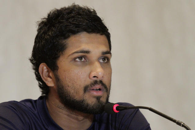 """FILE - In this Thursday, Nov. 9, 2017 file photo, Sri Lanka's Dinesh Chandimal attends a press conference prior to their cricket series against India in Kolkata, India. Sri Lanka's captain, coach, and manager have admitted to breaching the """"spirit of cricket"""" by refusing to play the West Indies for two hours during the second test in St. Lucia. Captain Dinesh Chandimal, coach Chandika Hathurusinghe and manager Asanka Gurusinha admitted to the charge laid by International Cricket Council chief executive David Richardson following the test. (AP Photo/Bikas Das, File)"""