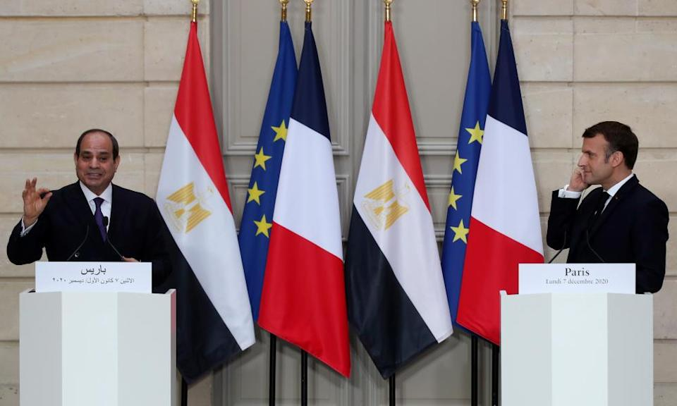 President Abdel Fatah al-Sisi, left, gives a join press conference with his French counterpart, Emmanuel Macron, in Paris on 07 December 2020.