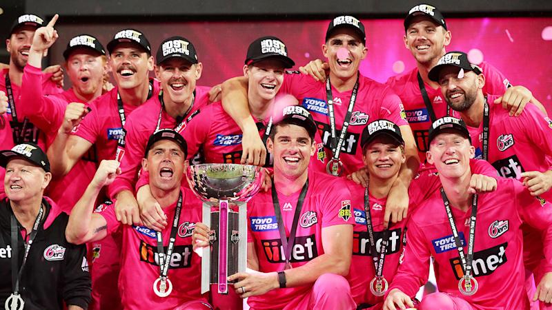 2019/20 Big Bash winners the Sydney Sixers are seen here celebrating their title.