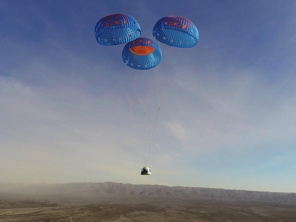 The New Shepard crew capsule parachutes to a landing at Blue Origin's Launch Site One in Texas on January 14.
