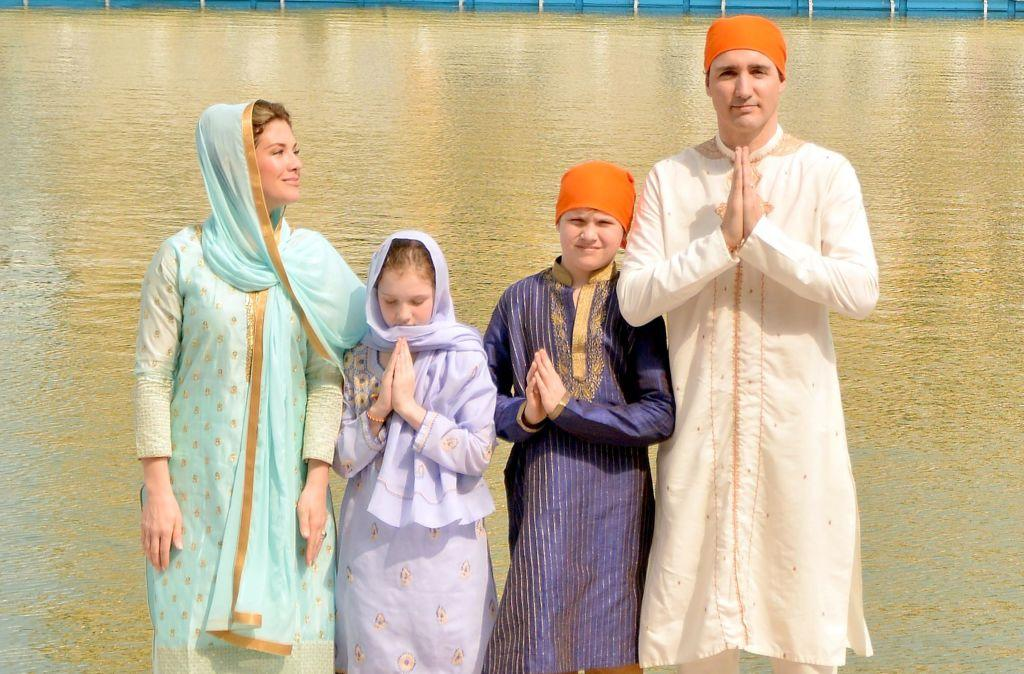 <p><strong>When: Feb. 21, 2018</strong><br /> The family, who has worn traditional Indian attire all week, greeted fans and had fun rolling out rotis in the Golden Temple Complex. <em>(Photo: Getty)</em> </p>