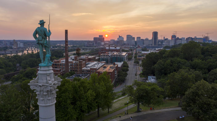 This photo shows the Statue of Confederate Soldiers & Sailors Monument on Libbie Hill as the sun sets in Richmond, Va., Monday, July 6, 2020. The 17-foot statue resting on a 73 foot pedestal is slated to be removed by the city along with the other Confederate monuments in the city. (AP Photo/Steve Helber)