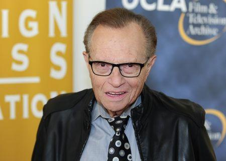 """FILE PHOTO: Television and radio host Larry King arrives at the opening night of the UCLA Film and Television Archive film series """"Champion: The Stanley Kramer Centennial"""" and the world premiere screening of the newly restored """"Death of a Salesman"""" in Los Angeles, California August 9, 2013. REUTERS/Gus Ruelas"""