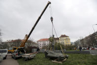 The statue of a Soviet World War II commander Marshall Ivan Stepanovic Konev is being removed from its site in Prague, Czech Republic, Friday, April 3, 2020. Marshall Konev led the Red Army forces that liberated Prague and large parts of Czechoslovakia from the Nazi occupation in 1945. His monument, unveiled in the Prague 6 district in 1980 when the country was occupied by Soviet troops, has been a source of controversy. (AP Photo/Petr David Josek)